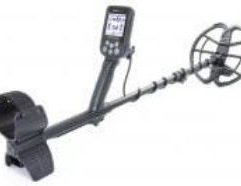 """Nokta Makro Simplex+ Waterproof Metal Detector with 11"""" DD Coil - 11000620 Product Description The NEW Nokta   Makro Simplex is an easy-to-use, budget-friendly metal detector that performs like high-end detectors. This detector is not only lightweight and compact enough to fit in a backpack, it also has excellent depth. It includes 4 search modes: All Metal, Park, Field and Beach. Not only does the Simplex+ include manual ground balance and notch discrimination but it is waterproof to 10 feet! It includes the option for wireless headphones. To update your Nokta Makro Simplex+ operating system, you can follow these instructions: CLICK HERE Just because it is low cost, you do not have to worry about missing targets. It will find them! Trashy areas are no match for the target separation on this detector. If you are new to the hobby, this is the perfect machine to turn on and go and actually unearth some great finds! The Simplex+ is an excellent machine for even a seasoned detectorist. Nokta Makro Simplex IP68: Fully submersible up to 3 meters (10 ft) and protected from total dust ingress. Iron Volume: Turns off or adjusts the volume of the low iron tone. Discrimination: Discriminates Target IDs of unwanted metals. Search Modes: All Metal / Field / Park / Beach Built-in Wireless Module: Compatible with 2.4 GHz Nokta Makro Green Edition Wireless Headphones. Vibration: SIMPLEX+ will vibrate upon detection of target! Ideal for the hearing impaired users as well as for detection underwater. Frequency Shift: Get rid of EMI easily by shifting the frequency in small increments. Fabulous Lighting for Night & Underwater Use: SIMPLEX+ has it all - LCD Backlight, Keypad Backlight and LED Flashlight. Warranty: 2 years PLEASE NOTE: This detector does not include a charging adapter. You can use a 5V 1A adapter (similar to the adapter included with a smartphone) to charge."""